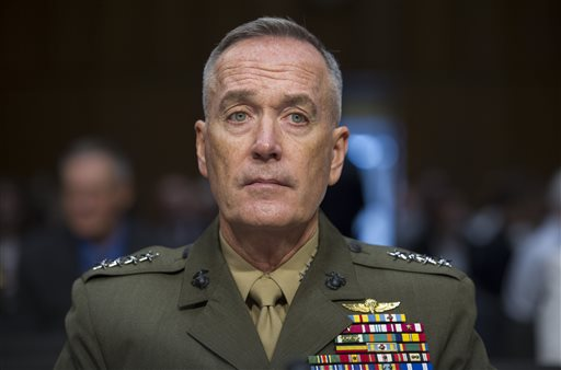 FILE - In this July 9, 2015, file photo, Marine Corps Commandant Gen. Joseph Dunford, Jr., testifies during his Senate Armed Services Committee confirmation hearing to become the Chairman of the Joint Chiefs of Staff, on Capitol Hill in Washington. The top U.S. military officer landed in Iraq Tuesday, Oct. 20, 2015, to get an update on the battle against Islamic State militants, saying he sees no prospect right now for Russia to expand its airstrike campaign into the war-torn country.(AP Photo/Cliff Owen, File)