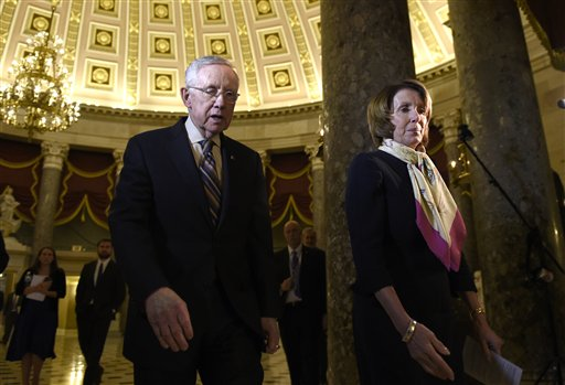 House Democratic Leader Nancy Pelosi of Calif., right, and Senate Minority Leader Harry Reid of Nev., left, walk to talk to reporters on Capitol Hill in Washington, Wednesday, Oct. 28, 2015, about the passage of a budget by the House. (AP Photo/Susan Walsh)