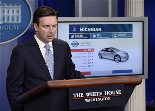White House press secretary Josh Earnest uses a graphic to discuss the Trans-Pacific Partnership (TPP) during the daily briefing at the White House in Washington, Tuesday, Oct. 13, 2015. Earnest also answered questions about Syria, Russia. (AP Photo/Susan Walsh)