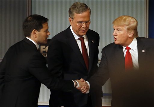 Marco Rubio and Donald Trump shake hands as Jeb Bush looks on during Republican presidential debate at Milwaukee Theatre, Tuesday, Nov. 10, 2015, in Milwaukee. (AP Photo/Morry Gash)