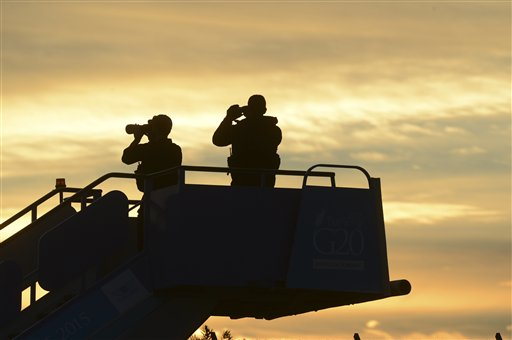 Security officials stand guard as they wait for the plane carrying US President Barack Obama to land in Antalya, Turkey, Sunday, Nov. 15 2015 for the G-20 summit. The 2015 G-20 Leaders Summit is held near the Turkish Mediterranean coastal city of Antalya on Nov. 15-16, 2015. (Ali Atmaca/Anadolu Agency via AP, Pool)