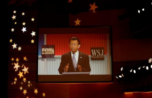Republican U.S. presidential candidate and Louisiana Governor Bobby Jindal is seen on a video monitor on a wall inside the debate hall during a forum for lower polling candidates held by Fox Business Network before the U.S. Republican presidential candidates debate in Milwaukee, Wisconsin, November 10, 2015. REUTERS/Darren Hauck - RTS6E1Y