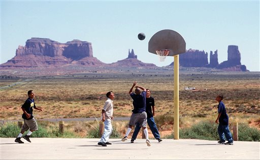 FILE - In this Aug. 27, 1997 file photo, students from Monument Valley High School on the Navajo Reservation in southeast Utah, play basketball during a lunch break during the first day of classes. The U.S. Census Bureau is testing new questions on tribal enrollment for the 2020 count in an effort to get a more accurate tally of American Indians. Census director John Thompson told The Associated Press on Tuesday, Nov. 17, 2015, that the agency is aiming to avoid a 5 percent undercount of the population seen in 2010. (Marc Lester/The Daily Herald via AP, File)