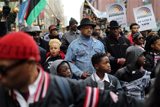 Rev. Jesse Jackson and the Rainbow PUSH Coalition lead a protest through the Loop in Chicago on Sunday, Dec. 6, 2015, in response to the Laquan McDonald shooting and continuing Chicago Police investigation. About 200 protesters are demonstrating following the release of documents showing that police officers' accounts of the 2014 killing of McDonald differed greatly from what was captured on dashcam video. (Brian Cassella/Chicago Tribune via AP)