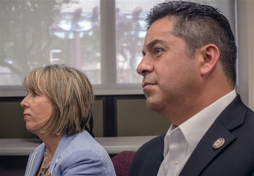FILE - This July 17, 2014 file photo shows U.S. reps. Michelle Lujan Grisham, left, and Ben Ray Lujan talk to reporters at the VA hospital in Albuquerque, N.M. The U.S. Department of Agriculture is embarking on a partnership with universities across the country in hopes of infusing its ranks with more diversity as it faces civil rights complaints from Latino farmers and ranchers. Lujan, a member of the Congressional Hispanic Caucus, said farmers and ranchers who have been discriminated against deserve to be made whole and that he looks forward to meeting with the secretary. (Roberto E. Rosales/Albuquerque Journal via AP)