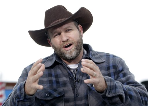 Ammon Bundy, one of the sons of Nevada rancher Cliven Bundy, speaks during an interview at Malheur National Wildlife Refuge, Tuesday, Jan. 5, 2016, near Burns, Ore. Law enforcement had yet to take any action Tuesday against a group numbering close to two dozen, led by Bundy and his brother, who are upset over federal land policy. (AP Photo/Rick Bowmer)