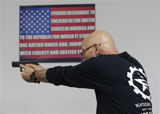 Mike Weinstein, director of training and security at the National Armory gun store and gun range, shows how to safely fire a Glock 9mm hand gun during a Concealed Weapons Permit class on Tuesday, Jan. 5, 2016, in Pompano Beach, Fla. President Barack Obama unveiled his plan Tuesday to tighten control and enforcement of firearms in the U.S. (AP Photo/Lynne Sladky)
