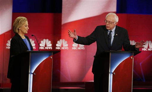 Democratic presidential candidate, Sen. Bernie Sanders, I-Vt,  answers a question as Democratic presidential candidate, Hillary Clinton gestures, during the NBC, YouTube Democratic presidential debate at the Gaillard Center, Sunday, Jan. 17, 2016, in Charleston, S.C. (AP Photo/Stephen B. Morton)