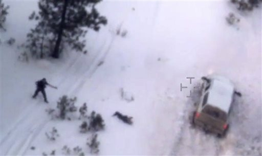 """This photo taken from an FBI video shows Robert """"LaVoy"""" Finicum after he was fatally shot by police Tuesday, Jan. 26, 2016 near Burns, Ore. A video released Thursday, Jan. 28, 2016 by the FBI of the shooting death of a spokesman for the armed occupiers of a wildlife refuge shows the man reaching into his jacket before he fell into the snow. The FBI said the man had a gun in his pocket. (FBI via AP)"""