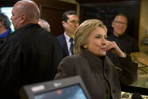 Democratic presidential candidate Hillary Clinton speaks with co-owner of the Puritan Backroom restaurant, as she picks up her order Sunday, Feb. 7, 2016, in Manchester, N.H. (AP Photo/Matt Rourke)