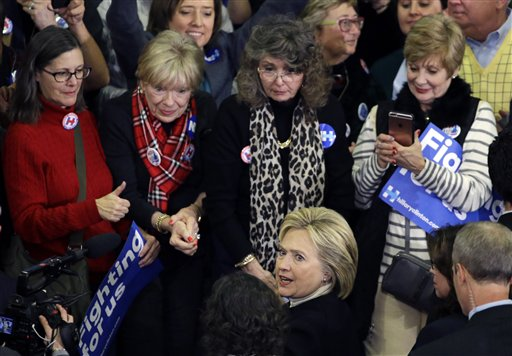 Democratic presidential candidate Hillary Clinton mingles with supporters at her New Hampshire presidential primary campaign rally, Tuesday, Feb. 9, 2016, in Hooksett, N.H. (AP Photo/Elise Amendola)