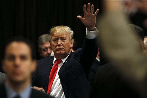 Republican presidential candidate Donald Trump waves during a campaign stop Friday, Feb. 19, 2016, in North Charleston, S.C. (AP Photo/Matt Rourke)