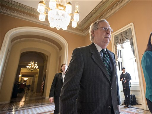 Senate Majority Leader Mitch McConnell walks to the chamber where he offered a tribute to the late Supreme Court Justice Antonin Scalia whose death has triggered an election-year political standoff, on Capitol Hill in Washington, Monday, Feb. 22, 2016.(AP Photo/J. Scott Applewhite)
