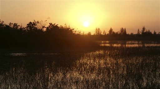 In this image made from video, the sun sets near an industrial park next to the Florida Everglades, Tuesday, Feb. 23, 2016, in Miami. Years before his Republican presidential bid, Marco Rubio pushed Miami-Dade County officials to allow a major industrial development to be built on restricted land near the Florida Everglades. That was two months after he backed a law as a member of the Florida Legislature that made it harder for people to challenge the kinds of developments he advocated for as a private attorney.  (AP Photo/Wilfredo Lee)
