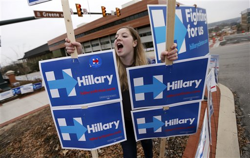 Abby Beauregard, a supporter for Democratic presidential candidate Hillary Clinton, rallies outside the University of South Carolina School of Law, where Clinton and competing candidate Bernie Sanders are to participate in a CNN town hall style televised event in Columbia, S.C., Tuesday, Feb. 23, 2016. (AP Photo/Gerald Herbert)