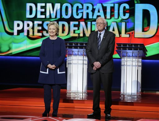 Democratic presidential candidates Hillary Clinton, left, and Sen. Bernie Sanders, I-Vt., stand stage before a Democratic presidential primary debate at the University of Michigan-Flint, Sunday, March 6, 2016, in Flint, Mich. (AP Photo/Charlie Neibergall)