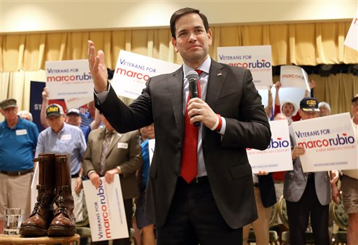 Sen. Marco Rubio, a Republican Presidential candidate, speaks during a rally with a pair of Gen. George Patton's boots beside him as veterans hold signs at the Rohan Recreation Center in The Villages, Fla. on Sunday, March 13, 2016. (Bruce Ackerman/Star-Banner via AP)