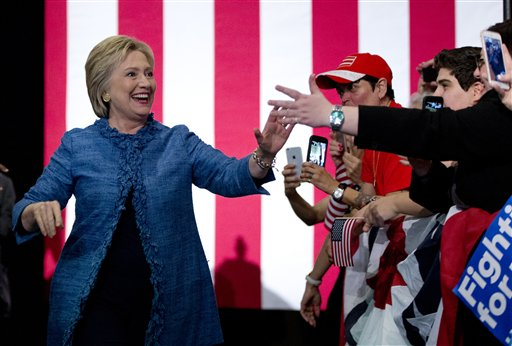 Democratic presidential candidate Hillary Clinton arrives to a cheering crowd at an election night event at the Palm Beach County Convention Center in West Palm Beach, Fla., Tuesday, March 15, 2016. (AP Photo/Carolyn Kaster)