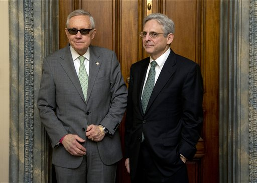 Senate Minority Leader Harry Reid, D-Nev., left, meets Supreme Court nominee Merrick Garland in his office on Capitol Hill in Washington, Thursday, March 17, 2016. (AP Photo/Manuel Balce Ceneta)