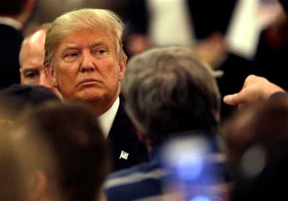 Republican presidential candidate Donald Trump looks to supporters as he leaves a campaign stop Wednesday, March 30, 2016, in Appleton, Wis. (AP Photo/Nam Y. Huh)