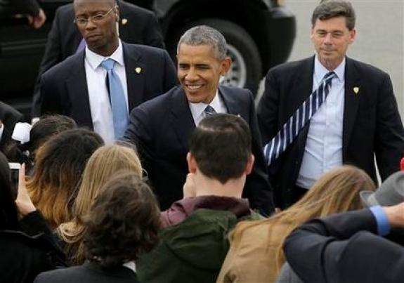 President Barack Obama smiles as he greets guests after arriving on Air Force One at San Francisco International Airport in San Francisco, Friday, April 8, 2016. (AP Photo/Jeff Chiu)