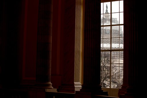 In this photo taken Feb. 9, 2016, The Capitol Dome is visible through a window in the Cannon House Office Building on Capitol Hill in Washington. An Associated Press-GfK poll finds that most Americans are happy with their friends and family, feel good about their finances and are more or less content at work. It's government, particularly the federal government, that's making them see red.  (AP Photo/Andrew Harnik)