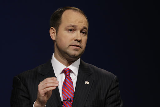 FILE - In this April 18, 2016, file photo, Indiana Republican candidate for U.S. Senate Marlin Stutzman speaks during a debate with opponent Todd Young in Indianapolis. Stutzman billed his campaign more than $2,000 in airfare for his family's trip to the Ronald Reagan library in California, an apparent violation of federal election laws. The expense is part of hundreds of thousands of dollars in travel expenses, meals and vehicle payments Stutzman has charged to his campaign fund since 2010. (AP Photo/Michael Conroy, File)