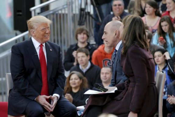 """U.S. Republican presidential candidate Donald Trump speaks during an interview with hosts Matt Lauer and Savannah Guthrie on NBC's """"Today"""" show in New York, April 21, 2016. REUTERS/Brendan McDermid"""