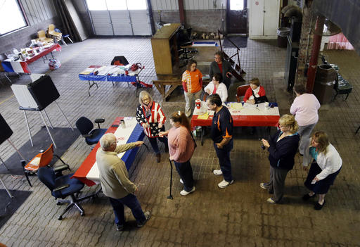 Voters wait to cast their ballot in the Indiana Primary at the Hamilton Co. Auto Auction, Tuesday, May 3, 2016, in Noblesville, Ind. (AP Photo/Darron Cummings)
