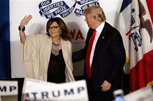"""FILE - In this Feb. 1, 2016, file photo, Republican presidential candidate Donald Trump is joined on stage by former Republican vice presidential candidate, and former Alaska Gov. Sarah Palin during a campaign event, in Cedar Rapids, Iowa. Palin said Sunday, May 8, 2016, that House Speaker Paul Ryan's statement that he isn't ready to embrace Trump """"was not a wise decision of his."""" (AP Photo/Mary Altaffer, File)"""