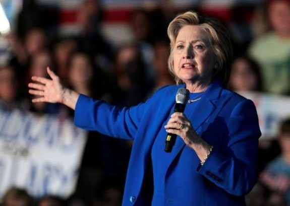 U.S. Democratic presidential candidate Hillary Clinton addresses the crowd during a campaign rally in the Hall of Fame Pavilion at Louisville Slugger Field in Louisville, Kentucky, U.S., May 10, 2016. REUTERS/John Sommers II