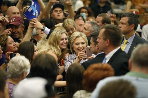 Democratic presidential candidate Hillary Clinton takes a selfie with supporters at a rally at Sacramento City College, Sunday, June 5, 2016, in Sacramento, Calif. (AP Photo/John Locher)