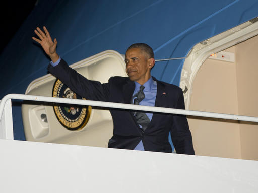 President Barack Obama waves as he boards Air Force One, Wednesday, June 8, 2016 at JFK International Airport in New York. Obama traveled to New York for a Democratic fundraiser and tape an appearance on the Tonight Show with Jimmy Fallon. (AP Photo/Pablo Martinez Monsivais)