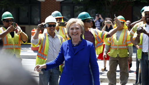 Democratic presidential candidate Hillary Clinton smiles after greeting workers after a stop at Uprising Muffin Company, Friday, June 10, 2016, in Washington. (AP Photo/Alex Brandon)