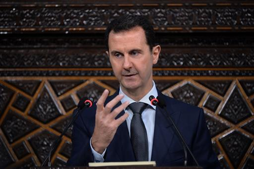 Syrian President Bashar Assad speaks in Damascus, Syria, Tuesday, June 7, 2016. (SANA via AP)