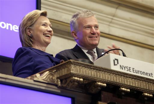 Secretary of State Hillary Rodham Clinton, rings the New York Stock opening bell, accompanied by then-NYSE CEO Duncan L. Niederauer, in New York in 2009. (AP Photo/Richard Drew)