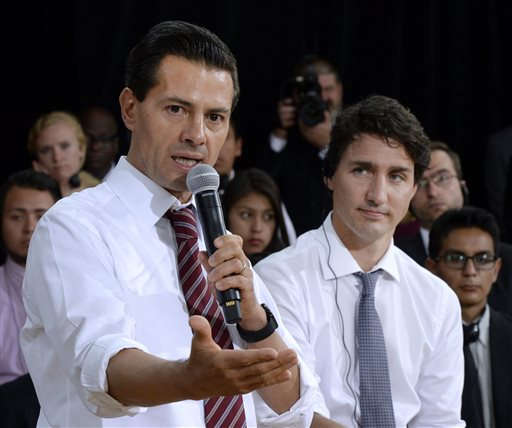 Canada's Prime Minister Justin Trudeau, right, listens as Mexico's President Enrique Pena Nieto answers a question during a Q&A with youth at the Museum of Nature, on Tuesday, June 28, 2016 in Ottawa. (Justin Tang/The Canadian Press via AP) MANDATORY CREDIT