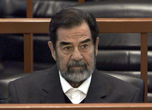 In this Dec. 6, 2006 file photo, former Iraq leader Saddam Hussein sits in court in Baghdad, Iraq. (AP Photo/Chris Hondros, Pool)
