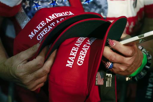 "Trump's ""Make America Great Again"" hats proudly tout they are ""Made in USA."" Not necessarily always the case, an Associated Press review found. (AP Photo/Jae C. Hong)"