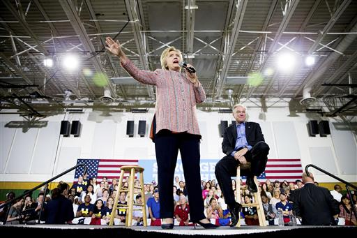 Democratic presidential candidate Hillary Clinton, accompanied by Sen. Tim Kaine, D-Va., right, speaks at a rally at Northern Virginia Community College in Annandale, Thursday, July 14, 2016. Kaine has been rumored to be one of Clinton's possible vice president choices. (AP Photo/Andrew Harnik)