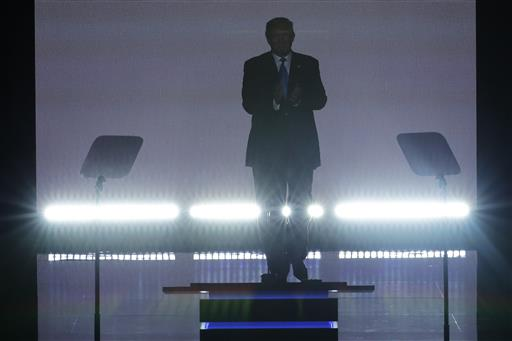Republican Presidential Candidate Donald Trump applauds as he steps to the podium to introduce his wife Melania during the opening day of the Republican National Convention in Cleveland, Monday, July 18, 2016. (AP Photo/J. Scott Applewhite)