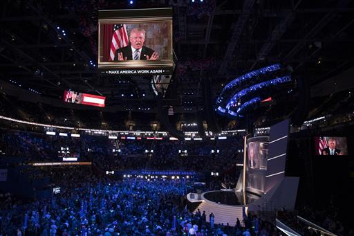 Republican presidential candidate Donald Trump appears on a video monitor during the Republican National Convention, Tuesday, July 19, 2016, in Cleveland. (AP Photo/Evan Vucci)