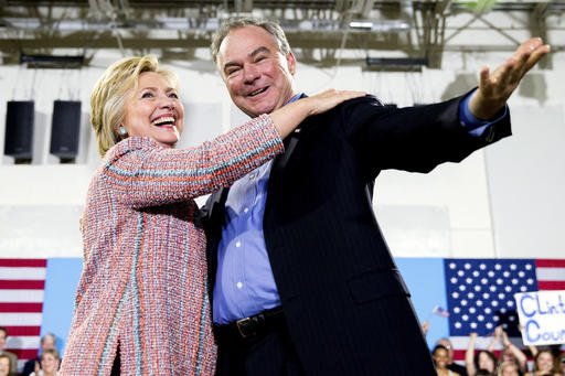 Democratic presidential candidate Hillary Clinton, accompanied by Sen. Tim Kaine, D-Va., speaks at a rally at Northern Virginia Community College in Annandale, Va. Clinton has chosen Kaine to be her running mate (AP Photo/Andrew Harnik)