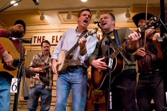 Virginia Senator Tim Kaine (right) with Sen. Mark Warner on stage of The Friday Night Jamboree in Floyd, Virginia. (Photo by Doug Thompson)