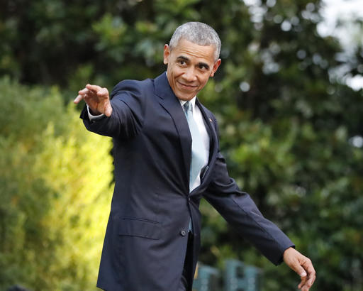 FILE - In this Wednesday, July 27, 2016 file photo, President Barack Obama waves as he walks out to the South Lawn of the White House in Washington, before boarding Marine One helicopter for the short flight to nearby Andrews Air Force Base. Obama is touting strides in reducing homelessness among military veterans as his administration reaches the halfway point in building a massive database on veterans' health. (AP Photo/Pablo Martinez Monsivais, File)
