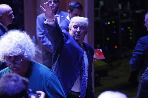 Republican presidential candidate Donald Trump waves as he leaves a campaign rally at Merrill Auditorium, Thursday, Aug. 4, 2016, in Portland, Maine (AP Photo/Evan Vucci)