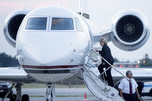 Democratic presidential candidate Hillary Clinton boards a plane at Chicago Midway International Airport, in Chicago, Thursday, Aug. 11, 2016, to travel to Westchester, N.Y. Clinton gave a speech on the economy after touring Futuramic Tool & Engineering in Warren, Mich., and attended a fundraiser in Chicago. (AP Photo/Andrew Harnik)