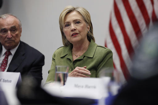 Democratic presidential candidate Hillary Clinton, joined by New York Police Department Commissioner Bill Bratton, left, and others, meets with law enforcement leaders at John Jay College of Criminal Justice in New York, Thursday, Aug. 18, 2016. (AP Photo/Carolyn Kaster)