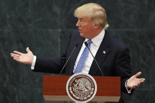 Republican presidential nominee Donald Trump speaks during a joint statement with Mexico's President Enrique Pena Nieto in Mexico City, Wednesday, Aug. 31, 2016. Trump is calling his surprise visit to Mexico City a 'great honor.' The Republican presidential nominee said after meeting with Peña Nieto that the pair had a substantive, direct and constructive exchange of ideas. (AP Photo/Dario Lopez-Mills)