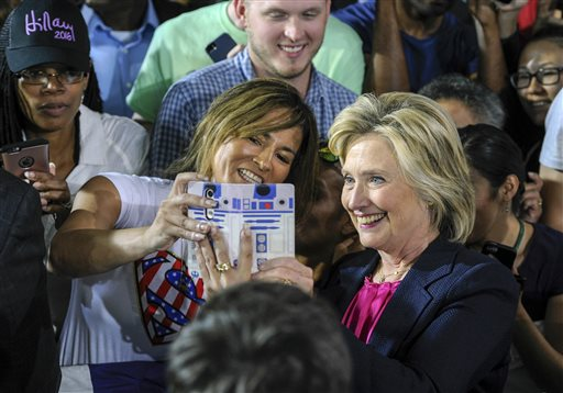 Democratic presidential candidate Hillary Clinton poses for a photo with supporters at a rally at the University of South Florida in Tampa, Fla., Tuesday, Sept. 6, 2016. (Monica Herndon/Tampa Bay Times via AP)